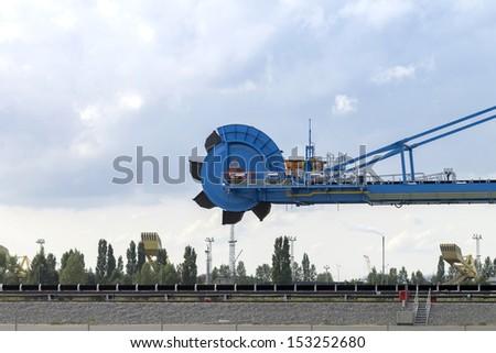 Bucket wheel in the port of Gdansk - stock photo