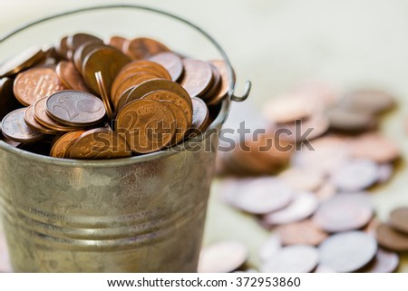 bucket with coins  - stock photo