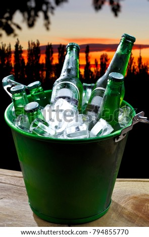 Bucket with ice and bottles of beer