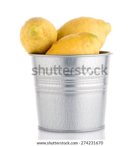 Bucket with lemons on white background - stock photo