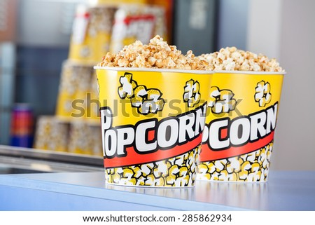 Buckets full of popcorn at concession stand in cinema - stock photo