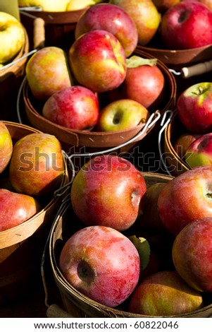 Buckets of apples for sale at a farmer's market - stock photo