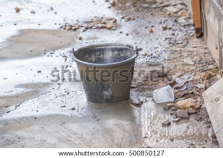 Buckets of cement use construction sand.