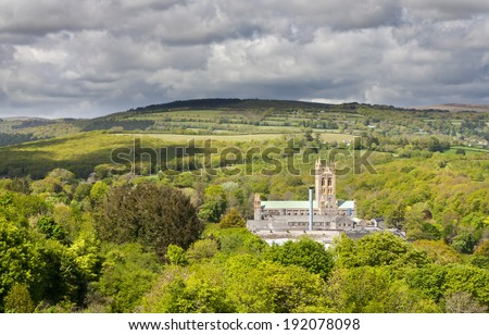 Buckfast Abbey from high up on Dartmoor. - stock photo