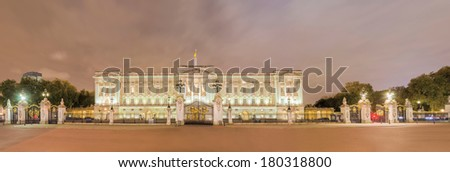 Buckingham palace in London at night panorama - stock photo