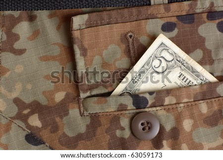 bucks in the uniform pocket - stock photo