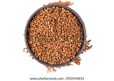 Buckwheat groats in a bowl, close up photo