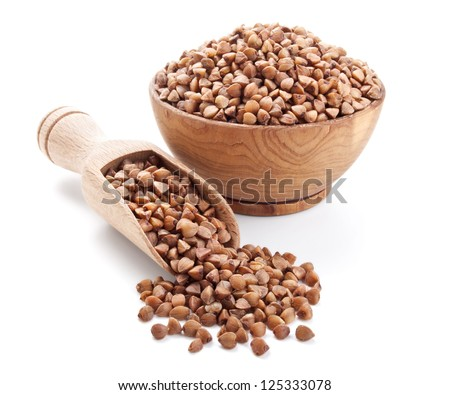 buckwheat in a wooden bowl isolated on white background - stock photo