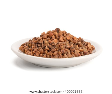 buckwheat in bowl isolated on white background