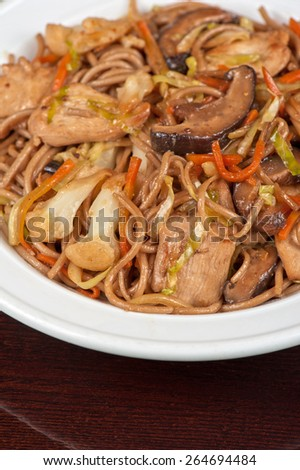 buckwheat noodles with chicken vegetables mushrooms and teriyaki sauce - stock photo