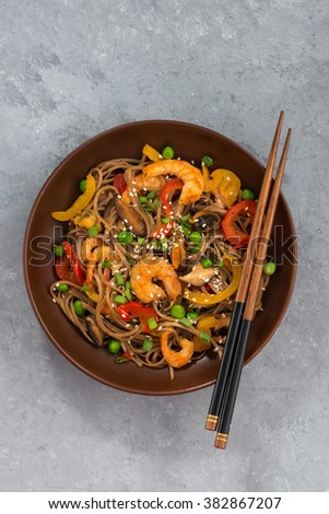 Buckwheat noodles with seafood and vegetables, vertical