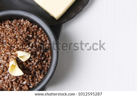 buckwheat porridge on a wooden table in the dish