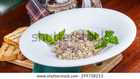 Buckwheat porridge with duck and apples
