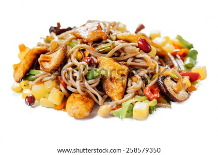Buckwheat soba noodles with chicken on a white background - stock photo