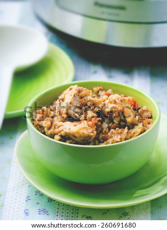 buckwheat with vegetables and chicken prepared in the crock-pot. selective focus. the image is tinted - stock photo