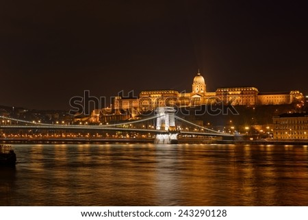 Buda Castle by the Danube river illuminated at night in Budapest, Hungary. - stock photo