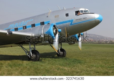 BUDAORS, HUNGARY - APRIL 27: Li-2 aircraft starting engines on 27th April, 2014. This aircraft is 65 years old. - stock photo