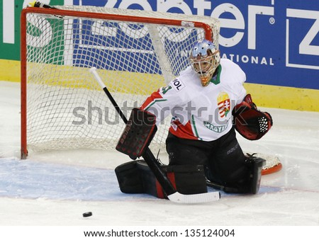 BUDAPEST - APRIL 14: Hungarian goalie Levente Super saves during Great Britain vs. Hungary IIHF World Championship ice hockey match at Budapest Sportarena on April 14, 2013 in Budapest, Hungary. - stock photo