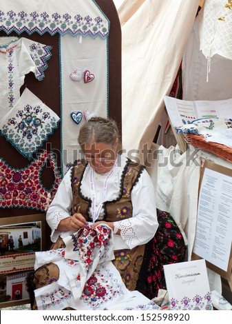 BUDAPEST - AUGUST 17: Unidentified woman makes traditional embroidery at the Festival of Folk Arts August 17, 2013 in Budapest, Hungary.