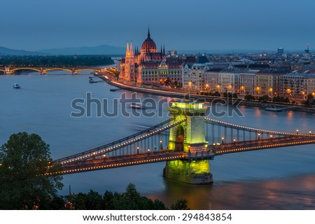 Budapest Chain Bridge, green glow on the Chain bridge in Budapest, as the night lights are warming up