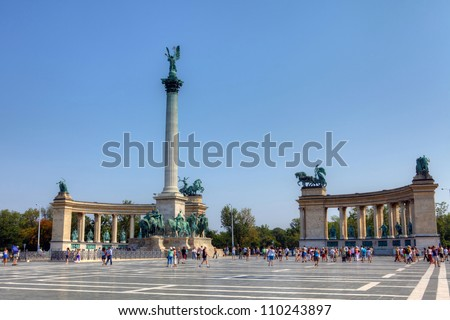 BUDAPEST - CIRCA AUGUST 2012 : Tourists visit Millennium Monument at Heroes Square circa August 2012 in Budapest, Hungary. This square has been UNESCO World Heritage site since 2002.