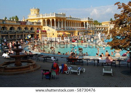 BUDAPEST - CIRCA SEPTEMBER 2009: People have a thermal bath in the Szechenyi spa circa September 2009 in Budapest. Szechenyi Medicinal Bath is the largest medicinal bath in Europe. - stock photo