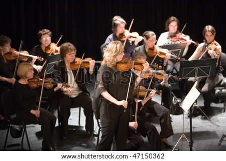 BUDAPEST - FEBRUARY 16: Members of the Pest Country Symphonic Orchestra perform at Urania Hall on February 16, 2010 in Budapest, Hungary.