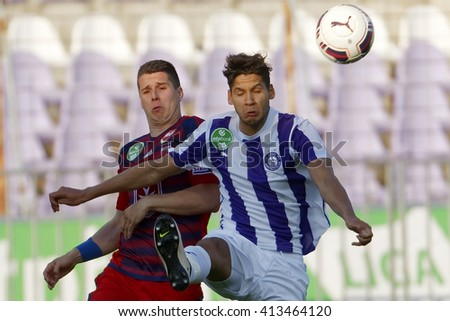 BUDAPEST, HUNGARY - APRIL 30, 2016: Akos Kecskes of Ujpest (r) fights for the ball with Patrik Tischler of Videoton during Ujpest - Videoton OTP Bank League football match at Szusza Stadium. - stock photo
