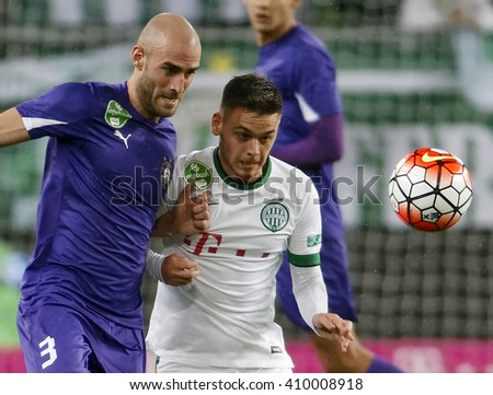 BUDAPEST, HUNGARY - APRIL 23, 2016: Andras Rado of Ferencvaros (r) duels for the ball with Jonathan Heris of Ujpest during Ferencvaros - Ujpest OTP Bank League football match at Groupama Arena. - stock photo