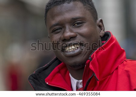 Budapest, Hungary - April  11. 2016: Big guy with a big smile at the street posing in front of camera
