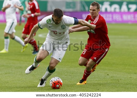 BUDAPEST, HUNGARY - APRIL 13, 2016: Daniel Bode of Ferencvaros (l) duels for the ball with Mihaly Korhut of DVSC during Ferencvaros - DVSC Hungarian Cup semi-final football match at Groupama Arena. - stock photo
