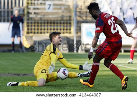 BUDAPEST, HUNGARY - APRIL 30, 2016: Goalkeeper David Banai of Ujpest (l) saves a shot from Stopira of Videoton during Ujpest - Videoton OTP Bank League football match at Szusza Stadium.