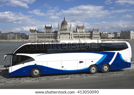 BUDAPEST, HUNGARY - APRIL 04, 2015: Hungarian Parliament Building and in foreground a modern two level  tourist bus - stock photo