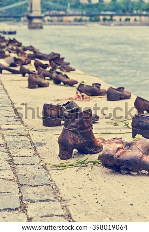 BUDAPEST, HUNGARY - APRIL 2, 2015: Iron shoes memorial to Jewish people executed WW2 in Budapest Hungary - stock photo