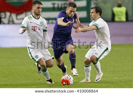 BUDAPEST, HUNGARY - APRIL 23, 2016: Kylian Hazard of Ujpest breaks out between Andras Rado (l) and Tamas Hajnal (r) of Ferencvaros during FTC - Ujpest OTP Bank League football match at Groupama Arena. - stock photo