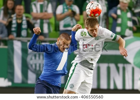 BUDAPEST, HUNGARY - APRIL 16, 2016: Michal Nalepa of Ferencvaros (r) battles for the ball in the air with Darko Nikac of MTK during Ferencvaros - MTK OTP Bank League football match at Groupama Arena.  - stock photo