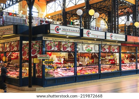 BUDAPEST, HUNGARY - 29 APRIL, 2014: People shopping in the Great Market Hall on April 29, 2014 in Budapest, Hungary. Great Market Hall is the largest indoor market in Budapest, it was built in 1896. - stock photo