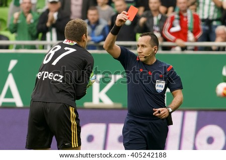 BUDAPEST, HUNGARY - APRIL 13, 2016: Referee Ferenc Karako shows the red card for Istvan Verpecz of DVSC during Ferencvaros - DVSC Hungarian Cup semi-final football match at Groupama Arena. - stock photo