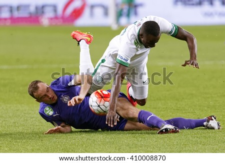 BUDAPEST, HUNGARY - APRIL 23, 2016: Robert Litauszki of Ujpest slide tackles Roland Lamah of Ferencvaros (r) during Ferencvaros - Ujpest OTP Bank League football match at Groupama Arena.