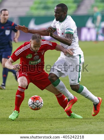 BUDAPEST, HUNGARY - APRIL 13, 2016: Roland Lamah of Ferencvaros (r) fights for the ball with Dusan Brkovic of DVSC during Ferencvaros - DVSC Hungarian Cup semi-final football match at Groupama Arena. - stock photo