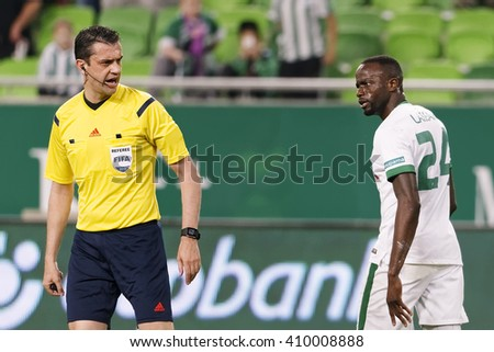 BUDAPEST, HUNGARY - APRIL 23, 2016: Roland Lamah of Ferencvaros (r) looks angry at Viktor Kassai during Ferencvaros - Ujpest OTP Bank League football match at Groupama Arena.