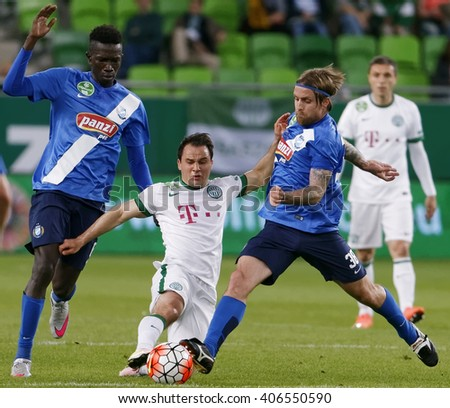 BUDAPEST, HUNGARY - APRIL 16, 2016: Tamas Hajnal of FTC fights for the ball with Adam Vass (r) and Thiam Khaly Iyane of MTK during Ferencvaros - MTK OTP Bank League football match at Groupama Arena.  - stock photo