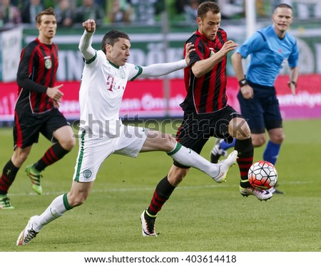 BUDAPEST, HUNGARY - APRIL 10, 2016: Vladan Cukic of Ferencvaros (l) duels for the ball with Marton Eppel of Honved during Ferencvaros - Budapest Honved OTP Bank League football match at Groupama Arena - stock photo