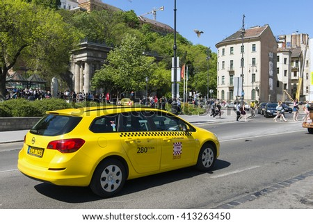 BUDAPEST, HUNGARY - APRIL 26 2016: yellow taxi in Budapest, Hungary