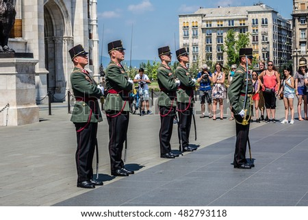 BUDAPEST, HUNGARY - AUGUST 5, 2016: Changing of the guard near Famous Hungarian Parliament Building. Parliament building is a popular tourist destination of Budapest.