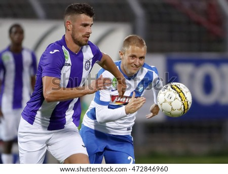 BUDAPEST, HUNGARY - AUGUST 21, 2016: Nagy (L) of Ujpest FC competes for the ball with Szabolcs Varga (R) of MTK during the OTP Bank Liga match between Ujpest FC and MTK Budapest at Illovszky Stadium.