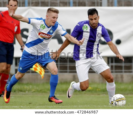 BUDAPEST, HUNGARY - AUGUST 21, 2016: Nemanja Andric (R) of Ujpest competes for the ball with Balint Vogyicska (L) of MTK during the OTP Bank Liga match between Ujpest FC and MTK at Illovszky Stadium