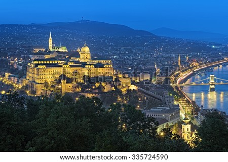 Budapest, Hungary. Buda Castle with Royal Palace and Matthias Church at evening, view from Gellert Hill. - stock photo