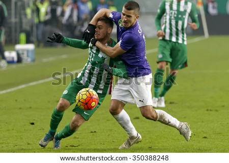 BUDAPEST, HUNGARY - DECEMBER 12, 2015: Andras Rado of Ferencvaros (l) is fouled by Bojan Sankovic of Ujpest during Ferencvaros - Ujpest OTP Bank League football match at Groupama Arena.