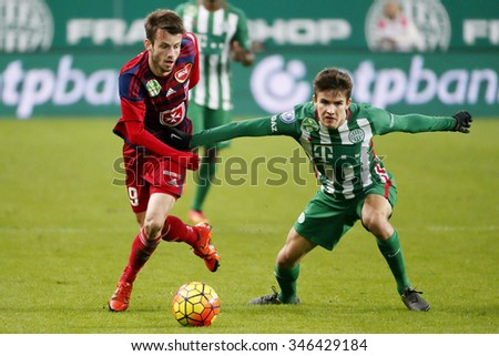 BUDAPEST, HUNGARY - DECEMBER 2, 2015: Duel between Adam Nagy of Ferencvaros (r) and Asmir Suljic of Videoton during Ferencvaros - Videoton OTP Bank League football match at Groupama Arena. - stock photo